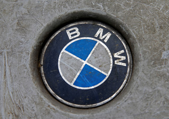 Destroyed BMW logo are seen on the wheel in this picture illustration taken