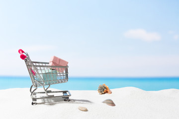 Summer shopping.  Business and selling on beach. Cart on white sand