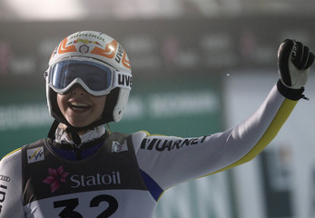 Runggaldier of Italy smiles after her jump during the women's ski jumping individual normal hill final at the Nordic Ski World Championships in Oslo