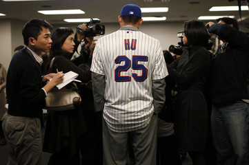 Hu of Taiwan speaks to members of the media at a news conference where he was introduced as the newest member of the New York Mets baseball team in New York