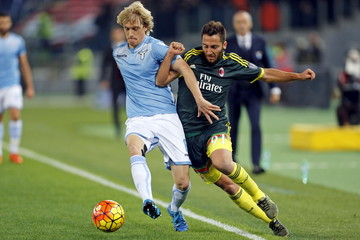 AC Milan's Bertolacci and Lazio's Basta fight for the ball during their Serie A soccer match in Rome