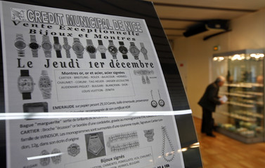 A placard announces an auction of jewels pawned by their owners at the Credit Municipal public pawnbroker in Nice
