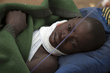 Wangouma Nestor lies on a stretcher in Camp de Roux, a main base recently abandoned by former Seleka fighters near Bangui