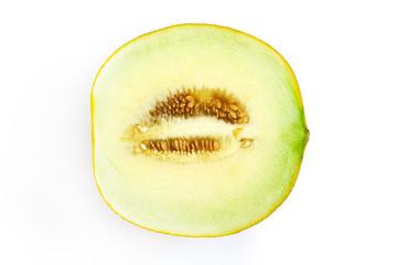 Half of sweet ripe muskmelon (galia melon) isolated on white background