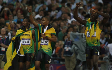 Jamaica's Usain Bolt celebrates with his compatriots Yohan Blake and Warren Weir after winning the men's 200m final at the London 2012 Olympic Games at the Olympic Stadium