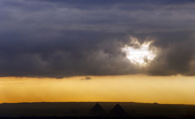 Cloudy skies are seen over he Great Pyramids of Giza during the fifth anniversary of the uprising that ended the 30-year reign of Hosni Mubarak in Cairo