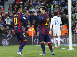 Barcelona's Messi celebrates his hat-trick with teammate Neymar during their Spanish first division soccer match against Levante at Nou Camp stadium in Barcelona
