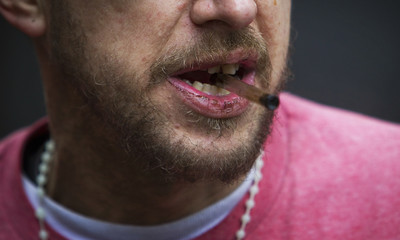 A man holds his used crack pipe in Vancouver's DTES neighbourhood