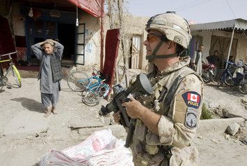 Pete Christie, Toronto Police Sergeant, patrols with U.S. soldiers in the town of Kandahar, southern Afghanistan