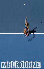 Benesova of Czech Republic serves to Azarenka of Belarus during their match at the Australian Open tennis tournament