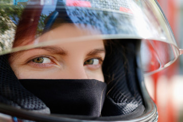Young girl in a motorcycle helmet
