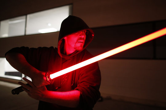 An instructor demonstrates his skill during a light saber tournament organized by the Sport Saber League in Paris, France