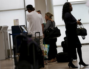 Tourists try to catch the last flight out of Puerto Vallata at the city's international airport as Hurricane Patricia approached the Pacific beach resort, Mexico