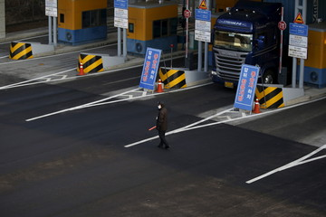 A security guard stands guard at a gateway at the South's CIQ, in Paju