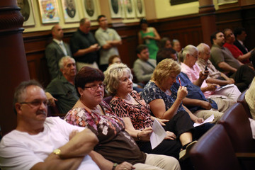 Audience members listen to the city council during its meeting in Scranton