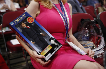 A delegate holds a Donald Trump doll as she sits in her seat at the Republican National Convention in Cleveland