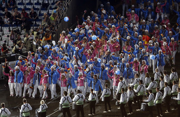 Members of Germany's contingent wave as they take part in the athletes parade during the opening ceremony of the London 2012 Olympic Games at the Olympic Stadium