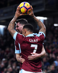 Burnley's Andre Gray celebrates scoring their third goal to complete his hat trick