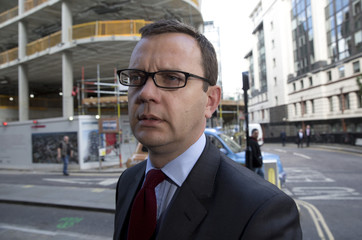 Former editor of the News of the World Andy Coulson arrives at the Old Bailey courthouse in London
