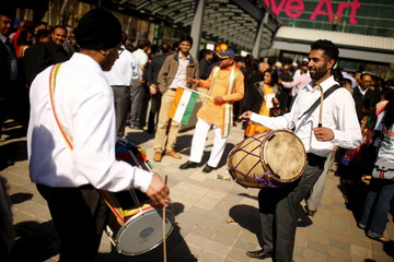 People play music ahead of India's Prime Minister Narendra Modi's speech in Toronto,