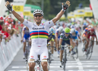 Garmin's team rider Hushovd of Norway celebrates winning ahead of Liquigas' team rider Sagan of Slovakia the fourth stage of the Tour de Suisse cycling race in Huttwil
