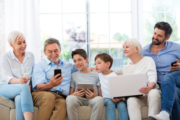 Family having fun with technology
