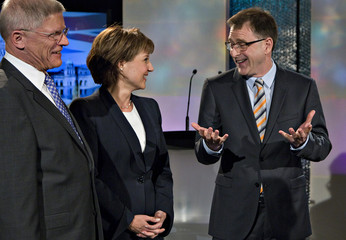 NDP leader Dix and Liberal leader Clark chat as Conservative leader Cummins looks on, prior to a provincial election TV debate in Vancouver