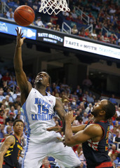 Tar Heels guard Hairston shoots around Terrapins guard/forward Wells during the second half of their ACC Championship college basketball game in Greensboro