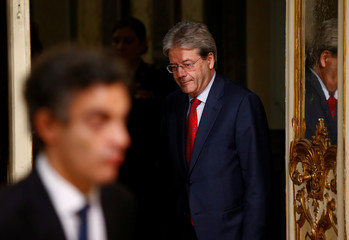 Italian Prime Minister Paolo Gentiloni arrive for joint news conference with Colombia's President Juan Manuel Santos during a meeting at Chigi Palace in Rome