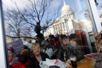 Massive crowds gather to see the 14 democratic senators that left the state to protest the bill proposed by the Gov. Scott Walker as crowds continue to protest at the Wisconsin State Capitol in Madison