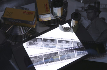 Eastman Kodak black and white film, negatives, film development reels and black and white photographic prints are shown in this studio illustration in Washington