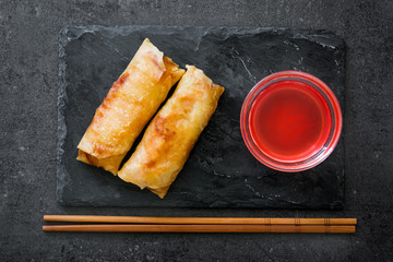 Vegetable spring rolls on black slate