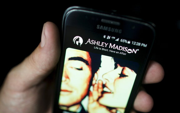 A photo illustration shows the Ashley Madison app displayed on a smartphone in Toronto