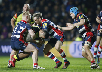 Leicester Tigers' Manu Tuilagi is tackled by Bristol's Jason Woodward and Adrian Jarvis