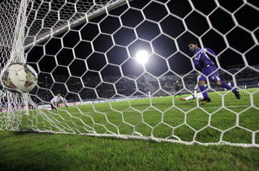Nicolas Olivera of Uruguay's Defensor Sporting scores a goal against Colombia's Atletico Nacional in Montevideo