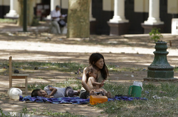 A Guarani Indian family rests at the Plaza Uruguay square in Asuncion