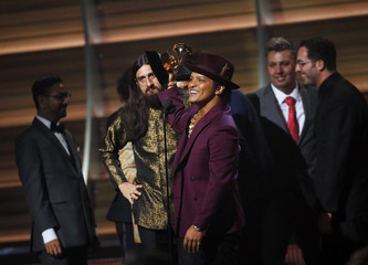 Bruno Mars accepts the Best Record of the Year award during the 58th Grammy Awards in Los Angeles