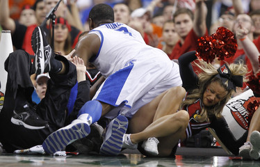 Kentucky Wildcats forward Terrence Jones falls into Louisville Cardinals cheerleaders during the men's NCAA Final Four semi-final college basketball game in New Orleans
