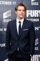 """Cast member Xavier Samuel walks the red carpet at the premiere of World War II film """"Fury"""" at the Newseum in Washington"""