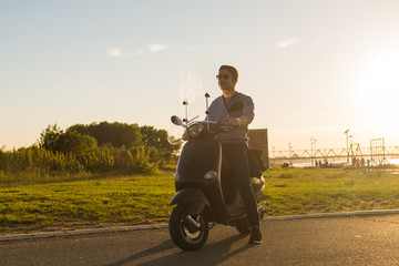 Young man on  motorcycle on  beautiful day