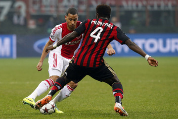 Ajax Amsterdam's van Rhijn fights for the ball with AC Milan's Muntari during their Champions League soccer match in Milan
