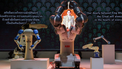 Robot arms perform during a synchronisation show to pay tribute to Thailand's late King Bhumibol Adulyadej at an exhibition hall in Bangkok