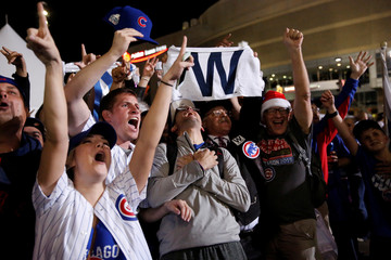 Fans of National League baseball team Chicago Cubs celebrate their Major League Baseball World Series game 7 victory against American League's Cleveland Indians outside Progressive Field in Cleveland, Ohio