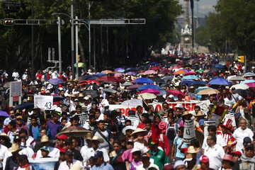 Demonstrators take part during a march for Labour Day in Mexico City