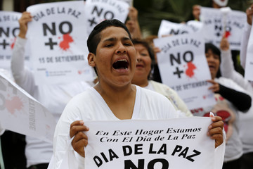 Inmates participate in an event ahead of the International Day of Peace at Santa Monica female prison in Lima