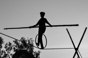 Young Boy Tightrope walking, Slacklining, Funambulism, Rope Balancing