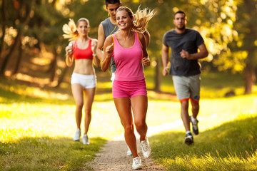 Young female jogging with her friends at the park.