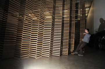 British artist Wilder kicks down his installation of 10,000 wooden slats 'Untitled # 155' at the Yorkshire sculpture park near Barnsley