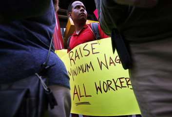 Low wage workers take part in a protest organized by the Coalition for a Real Minimum Wage outside the offices of New York Governor Andrew Cuomo