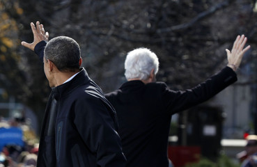 U.S. President Barack Obama and former President Bill Clinton wave in New Hampshire